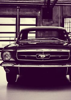 black and white image of a Ford Mustang Fast Back