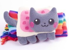 Nyan Cat Scarf - It's not a knitting or crochet pattern, but it gives me ideas. Nyan Cat, Cat Scarf, Geek Out, Grumpy Cat, Rainbow Colors, Cute Cats, Hello Kitty, Geek Stuff, Crafty