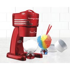 Make entertaining even more fun with this whimsical Nostalgia RISM900RETRORED Electric Shaved Ice Machine. This fun and easy to use Nostalgia RISM900RETRORED Electric Shaved Ice Machine produces snow-...