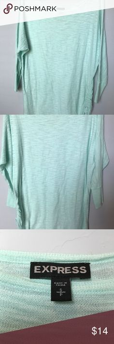 Express mint green top, with side ruche. Light weight mint green Express sweater/top. 3/4 sleeves. Excellent condition. Worn once. Tag with material makeup was removed due to being on side that ties. Express Tops Blouses