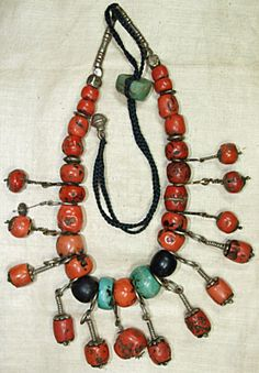 "Old Berber necklace from over 800 years ago; red coral, coin silver, brass, and amazonite. Very unique and authentic!  16"" strand of 32 coral beads, three amazonite beads, coin silver and brass metalwork. Missing one coral dangle."