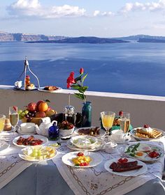 Captain's House, Santorini, Greece  The Breakfast: Bowls of thick Greek yogurt, local honey, and local fig jam; house-baked croissants; plates of eggs and spicy Mykonos sausage; Greek feta and local grapes; and French toast in a sauce blended from vin santo dessert wine and berries. Order breakfast any time of day to enjoy in your bed, on the shared terrace, or in the courtyard garden with views over the Aegean Sea.