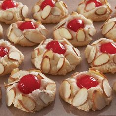 ~ Italian chewy almond cookies ~ 8 ounces almond paste ~ 1/2 cup sugar ~ 1 egg white ~ 1/2 teaspoon vanilla extract ~ Maraschino cherries , halved ~ sliced almonds ~