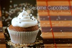 Airy sesame cupcake with a crisp shell, topped honey meringue frosting and black sesame seeds.