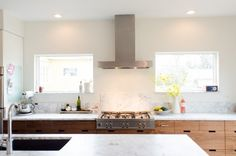 Faith's Kitchen Renovation: minimal backsplash, with a transition behind the stove