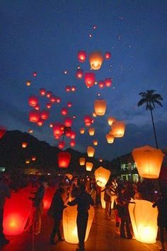 """I love this idea!   """"Wish lanterns will definitely light up your wedding or reception. wish lanterns, also known as floating lanterns originated in Thailand.  traditionally, each guest writes a wish for the newlyweds on the lanterns and then, all together, they are released and light up the evening sky.  believe it or not, they're eco-friendly and biodegradable too!"""""""