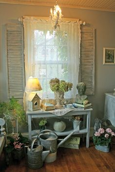 Cottage Garden Room Theme...Shabby Shutters...inside the room.  Many ideas on this blog.