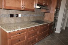 IRL the slate has a brownish color and gray and tan that kind of tie the cabinets, granite and floor together.