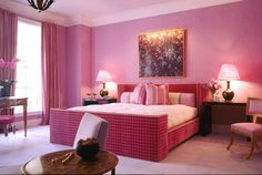 The main color in this monochromatic bedroom is pink, with darker pinks on the bed frame and other furniture, and lighter pinks on the ceiling and floor.