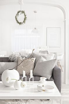White Vases from Cooee | White Kubus Line from By Lassen | Headphones from Kreafunk | Cushions from The White Company | Pelssau Sheepskin Rug from Milabert