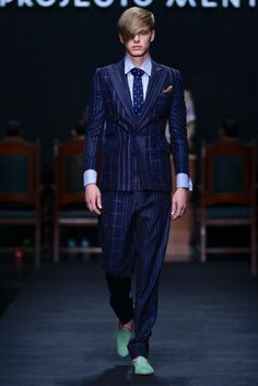 Just as expected from Angola. Colourful with American gentleman style sentiments. This is generally the fashion across much of the urban areas New York Socialites, Gentleman Style, Dapper Gentleman, African Clothing For Men, African Fashion Designers, Spring Summer, Summer 2014, South Africa, Pants