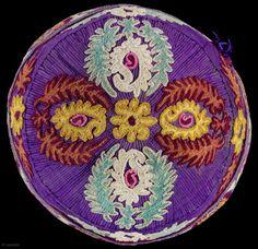 Uzbek Hat. Probably Samarkand. Circa 1930s.silk embroidery on purple silk; chain stitch outlines around motifs.
