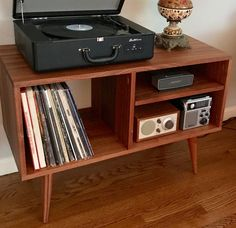 New mid century modern record player console, turntable, stereo cabinet with LP album storage. Avail in cherry, white oak or mahogany. Vinyl Record Cabinet, Record Player Cabinet, Record Player Stand, Stereo Cabinet, Record Players, Vinyl Storage, Record Storage, Modern Record Player, Wooden Cabinets
