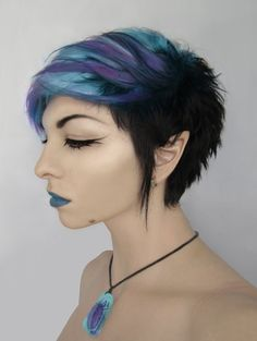 Purple and blue short alternative dyed hair Fixing the source, I LOVE Archaical (Her look reminds me of an elf....just saying. I LOVE IT)
