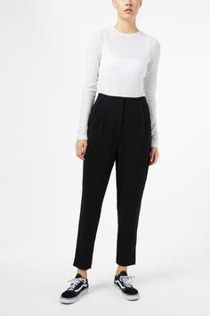 The Ewa Crepe Trousers are a pair of versatile, black trousers in a soft stretch material. They have a regular waist with an elasticated back for comfort,