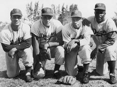 On the far right of this 1950 photo is Jackie Robinson, who made his immortal debut on April 15, 1947, becoming the first black player in Major League Baseball history. Next to him? Brooklyn Dodgers teammate Dan Bankhead, who on this day 65 years ago took the mound in the second inning and became MLB's first-ever black pitcher.