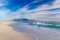 Wave breaking on Melkbosstrand beach with Table Mountain in the background. Atlantic Beach, Table Mountain, African Beauty, Cape Town, Continents, South Africa, Travel Inspiration, Landscapes, Places To Visit