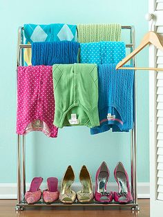 Avoid hanger-induced bumps by draping sweaters over a towel stand, using the extra space below for shoes. The rack fits under hanging clothes for perfect closet organization