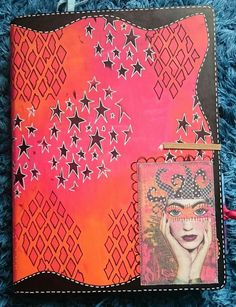 Sandra Botham/Red Kitty B Creates  Covered my new journal. Dylusions new paint colours cherry pie and tangerine dream. Plus some black. One of the new printed canvases on the bottom right..