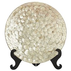 Add visual interest to a table or bookshelf with this oversized, exotic ivory platter, covered with shimmering capiz shells and resting on a lacquered brown stand. When your awed guests ask you where it came from, you can name an exotic locale. Sure, it stopped at Pier 1 on the way—but that's our little secret.