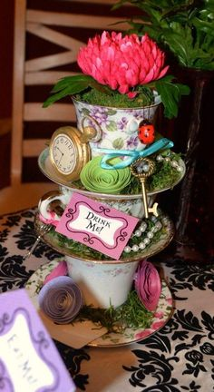 Mad hatter baby shower decor.... great use of teacups!!!