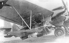 I-16 Polikarpov under wings of TB-3 Tupolev.
