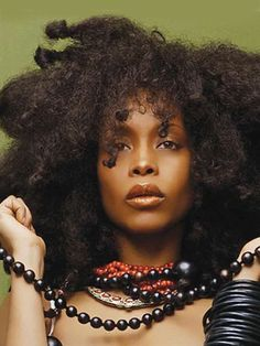 Erykah Badu, First Lady of Neo-Soul, was originally known for her headwrap but throughout her career she has changed hairstyle from afros, almost no hair, straighten, bobs, dreads, and headpieces.