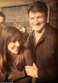 Love match: Krista Allen and Nathan Fillion Castle are this close. Both 44, he's never been married, she's twice-divorced