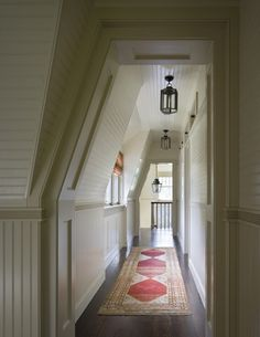 Hallway w/ great paneling. Great idea if you have to build a hallway into an attic / loft space.