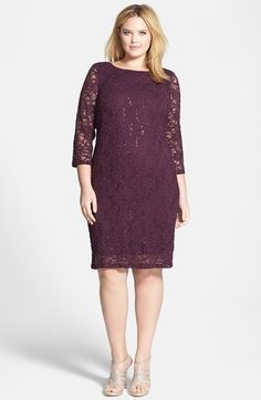 Sequin-sparked lace brings romantic glamour to a bateau-neck sheath dress cut for a shapely, but not tight, silhouette. Sheer three-quarter sleeves enhance the allure.
