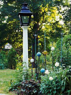 Going vertical helps unite a long garden. More design ideas: http://www.bhg.com/gardening/landscaping-projects/landscape-basics/whimsical-landscaping-design-ideas/?socsrc=bhgpin062014lookupwardpage=14