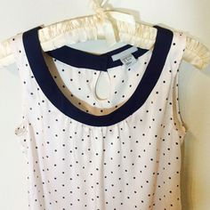 H&M polka dot top Pink top with navy blue polka dot. Gold buttons on the back. The top has a subtle metalic gloss to it                                                                             100% polyester H&M Tops Blouses