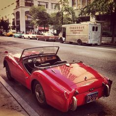 Another one of Dad's toys I loved cruising in with my dog Clancy....a classic Triumph TR3!
