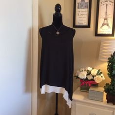 Max Studio Asymmetrical Tunic  Navy blue sleeveless tunic.  The flattering asymmetrical silhouette features a flowing white hemline.  Keyhole button back. Classic.  Max Studio Tops Tunics