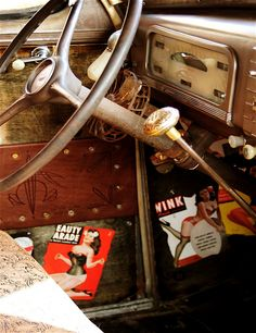 classic car interior with pinup pics