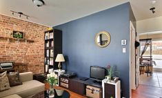 Blue gray wall and red brick wall Brick Fireplace Wall, Brick Wall Kitchen, Red Brick Fireplaces, Living Room With Fireplace, Interior Wall Colors, Brick Interior, Brick Bedroom, Accent Wall Bedroom, Brick Accent Walls