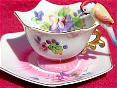 Bird Tea Cup And Saucer. I have a whole set of these in perfect condition. They are so cute when all set out together.