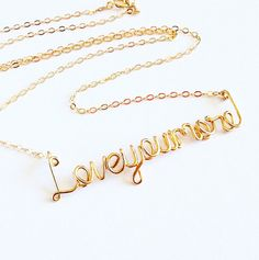 Gold Love you more necklace. Valentines Day Necklace. Aziza Jewelry