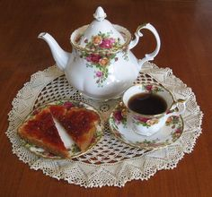 """My 3 o'clock routine includes refreshment to launch me into the evening hours. The Old Country Roses china pattern elevates this little routine to something a bit more elegant than a """"snack"""". Laid out on one of my favorite doilies it becomes almost regal."""