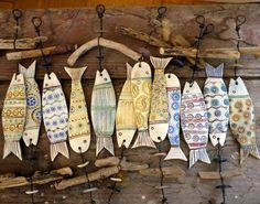 Handmade ceramic pottery fish plaque ornaments decorations.