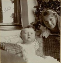 """delicate-flowers-of-the-past: """"""""A very sweet photo of Grand Duchess Olga Nikolaevna with her baby brother Tsarevich Alexei Nikolaevich. (source) """" """""""