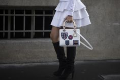 A patched Dior bag. #streetstyle accessories at Paris Fashion Week #PFW