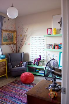 """This room was created for baby Elise and her parents wanted something """"fun, lively, eclectic, and colorful"""" and...on a budget. One of the best ways to save money is to put your DIY hat on and get to work, which is just what they did. Take a look around this room and see if you can guess their big money-saving do-it-yourself project."""