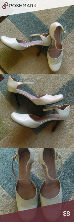 Nine West heels These shoes are leather and very comfortable. They are pre-loved and show some wear on the inside but have a lot of life still left. They have a 3 inch heel and an ankle strap that snaps on the side. The are really cute and the price reflects the condition. Nine West Shoes Heels