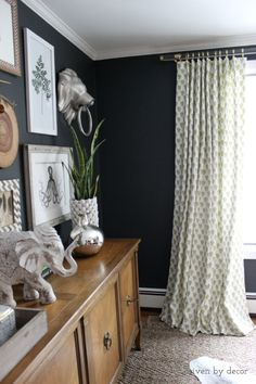 Charcoal walls || Gallery wall || Acrylic and brass drapery hardware