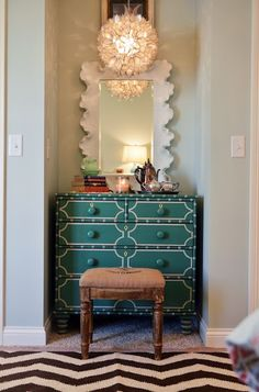 Gorgeous entry, love the pop of color | dresser with painted detail + capiz chandelier + mirror