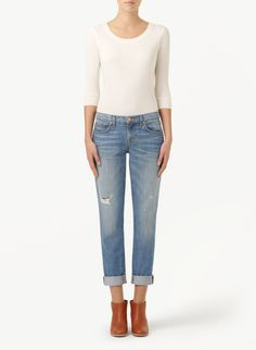 These mid-rise boyfriend jeans from J Brand come in a cotton denim that's specially washed and weathered. Heavy distressing and a lighter blue hue give them the look and feel of old vintage favourites.