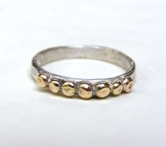 14k Gold ring and silver ring with Lovely 14k gold dots - made to order. $92.00, via Etsy.