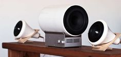 The Ceramic Subwoofer happens to look like a miniature version of an airplane turbine. Shiny, white and cylindrical, the Ceramic Subwoofer was created to complement the matching Ceramic Speakers designed over two years ago. Forgoing the wooden base, this sound system component rests on top of a stainless steel 50 watt Class D amp. Instead, the Baltic birch is incorporated into the body of the Ceramic Subwoofer.