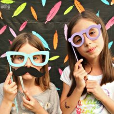 This party photo booth backdrop and prop set can be created for under $5 and in less than 5 minutes!